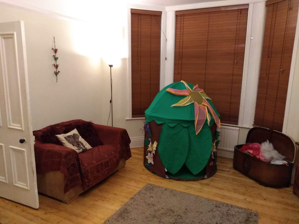 Living room with tent and dressing up box